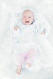 младенец смеясь над немного Стоковая Фотография