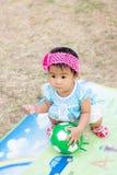 Младенец с футбольным мячом Стоковые Изображения