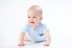 Младенец улыбки в сини стоковые фото
