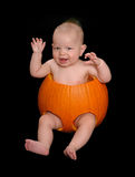 Младенец хеллоуина тыквы Стоковое Изображение
