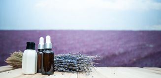 Ðœockup,   Serum oil and cream of lavender, a stylish set on the background  lavender. Field royalty free stock photo