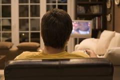 наблюдать tv стоковое изображение