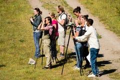 Наблюдатели птицы стоковое изображение