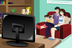 наблюдать телевидения семьи Стоковое Изображение