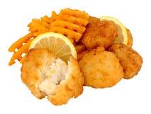 Наггеты рыб трески с фраями картошки решетки Стоковая Фотография RF