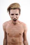 Нагой гомосексуальный парень screams в боли Стоковые Фотографии RF