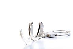 надевает наручники светлое тоновое изображение Стоковое фото RF