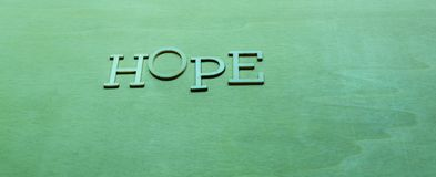 Надежда слова на зеленой предпосылке Стоковое Изображение