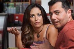 Надоеденные пары в кафе Стоковое фото RF