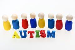 Надпись аутизма с диаграммами и на белой предпосылке Стоковое фото RF