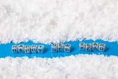 Надпись на Новом Годе снега счастливом стоковое фото rf