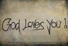 Надпись на стенах: Бог любит вас! на стене Стоковые Изображения