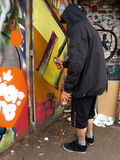 надпись на стенах художника с капюшоном Стоковая Фотография