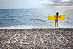 надпись свободного полета пляжа облицовывает женщину стоковые изображения rf