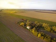 Над аграрными полями в заходе солнца осени Стоковые Фото