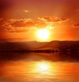 над заходом солнца моря Стоковое Фото