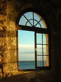 над окном захода солнца Стоковое Изображение