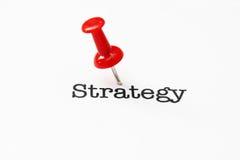 Нажмите штырь на тексте стратегии Стоковые Изображения RF