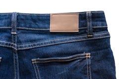 Назад голубых джинсов с кожаными джинсами ярлык зашил на голубых джинсах Стоковые Изображения