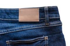 Назад голубых джинсов с кожаными джинсами ярлык зашил на голубых джинсах Стоковые Фотографии RF