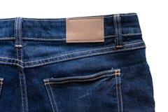 Назад голубых джинсов с кожаными джинсами ярлык зашил на голубых джинсах Стоковая Фотография RF