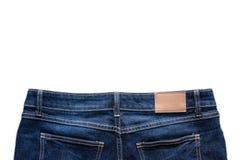 Назад голубых джинсов с кожаными джинсами ярлык зашил на голубых джинсах Стоковое Фото