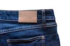 Назад голубых джинсов с кожаными джинсами ярлык зашил на голубых джинсах Стоковые Изображения RF