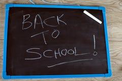 Назад к школе написанной на chalkboard Стоковое Изображение RF