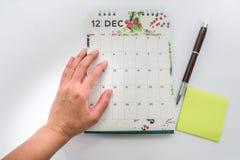 Назначение и встреча плана коммерсантки на декабря стоковая фотография