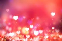 Накаляя запачканная предпосылка красного цвета сердец Фон ` s валентинки Стоковое Изображение
