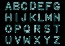 Накаляя Cyan голубой неоновый алфавит изолированный и прозрачный Шрифт handcrafted таможней для дизайна Стоковая Фотография