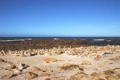 Накидка хорошей надежды, камни Африки сложенные туристами Стоковые Фотографии RF