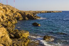 Накидка Greco Кипр на заходе солнца Стоковые Фотографии RF