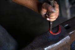 Наковальня, ботинок лошади и молоток Стоковое Изображение