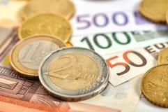 накрените веревочка примечания дег фокуса 100 евро 5 евро Стоковое Изображение
