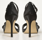 накрените высокие сандалии пар Стоковое Фото