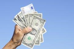 накрените евро доллара замечает нас Стоковое фото RF