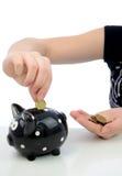 накрените облечение евро монеток piggy к Стоковое Изображение RF