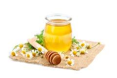 Накрените с свежим медом на белой предпосылке Стоковые Изображения