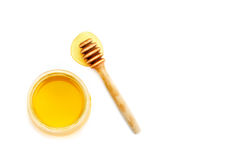 Накрените с свежим медом на белой предпосылке Стоковая Фотография RF