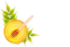 Накрените с свежим медом на белой предпосылке Стоковые Фото
