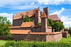накрените malbork замока здания кирпича самое большое напротив взгляда реки Стоковое Изображение