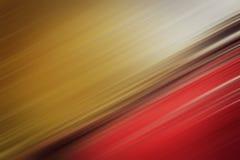 Наклоняя красным предпосылка запачканная золотом Стоковое Фото