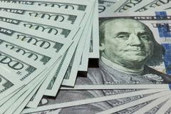Наличные деньги 100 долларов предпосылки Стоковое Изображение RF