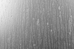 Намочите падения на стекле, падения дождя текстуры на стекле Стоковое фото RF