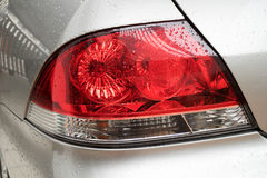 Намочите падения на автомобиле на свете задней части автомобиля Стоковые Фотографии RF