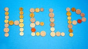 написанное слово помощи монеток Стоковые Изображения