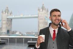 Напористый этнический бизнесмен показывая положительную эмоцию стоковая фотография rf