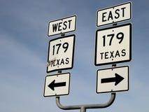 Направление дорожного знака восточное западное стоковое изображение rf