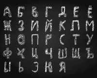 Нарисованный рукой мел кириллического алфавита doodle на борту Стоковая Фотография RF